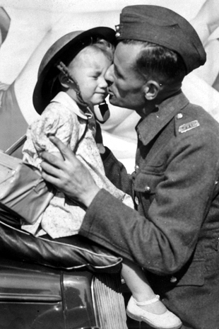 ww2_soldier_kissing_daughter_tin_hat